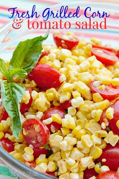 Fresh Grilled Corn and Tomato Salad, Grilled corn on the cob mixed with ripe grape tomatoes tossed in a light fresh basil vinaigrette!