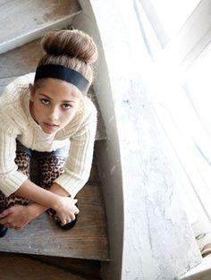 Ellie Lines stylist, bun, leopard pants, big knit jersey