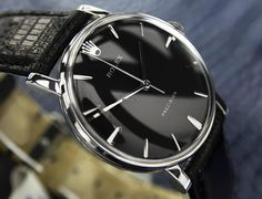 Rolex PRECISION watch for a vintage look Make it special with a custom color strap and matching dial. Blue dial with Brown strap. Black Dial black Strap White Dial with Light Brown strap. Usually starting around $2500 http://www.aandewatches.com/
