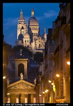 Church of Notre-Dame-de-Lorette with the Basilica of the Sacre Coeur behind at night. Paris, France