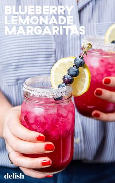 Beat The Heat With Blueberry Lemonade Margaritas Beat The Heat With Blueberry Lemonade MargaritasDelish Fruit Drinks, Bar Drinks, Cocktail Drinks, Cocktail Recipes, Beverages, Cocktail Club, Blueberry Margarita, Blueberry Lemonade, Blueberry Cake