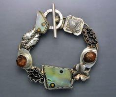 Bracelet | Temi Kucinski.  Sterling silver, natural hessonite garnet crystals, pastel ocean jasper cabochons