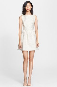 Free shipping and returns on Alice + Olivia 'Lillyanne' Jacquard Fit & Flare Dress at Nordstrom.com. Silvery metallic threads add shimmering depth to the floral jacquard-woven motif of a feminine frock tailored for a precise fit-and-flare silhouette. Glittering rhinestone buttons crown the back-baring cutout.