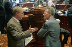 Michael Madigan, right, talks with John Lowder, his research director, last week on the House floor