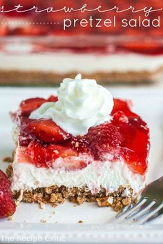 Strawberry Pretzel Salad at http://therecipecritic.com  Delicious layers with a sweet and salty pretzel crust, a cream cheese center and strawberry jello on top!  Summer desert perfection!