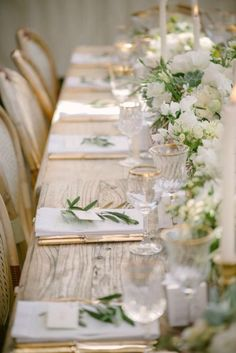 a palette of white and green is sophisticated and refined elegance. paired with a rustic table, interesting chairs and crystal and gold accents, this table setting is just lovely.