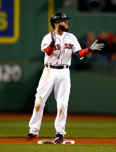 Dustin Pedroia #15 of the Boston Red Sox reacts after hitting an RBI double in the sixth inning against the Detroit Tigers during Game 2 of the ALCS