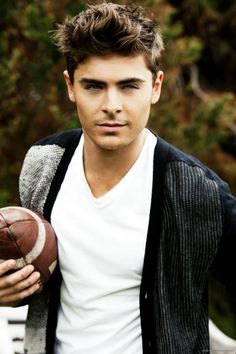 He must carry a football around a lot, because I see him with one a bunch. That's ok, though!