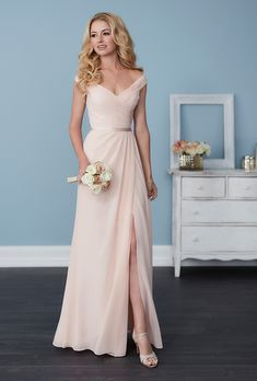 Christina Wu. Full-length A-line chiffon dress with pleated straps and bodice, a sweetheart neckline, and a cute satin belt. Available in a range of different colors.