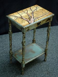 Upcycled furniture. Fun, little art project with a table that can be found at a yard sale.