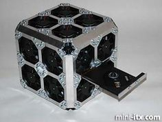 Massively fan-cooled cube. Unlike the all-fan case, this one looks beautiful and rugged.