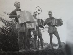 Four soldiers of the Deutsches Afrikakorps performing to troops in North Africa.