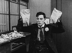 Buster Keaton in The Haunted House (1921). Hands up!