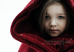 Snow photos are the BEST to do with children! For this, I put the blanket in the dryer at the first sign of snow, and then threw it around her, draping the top like a hood.  She was warm, and I was able to capture a beautiful photo!