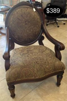 Rich chenille paisley upholstery accent the warm wood casing on this Victorian styled accent chair.