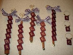 Ornaments (wire, ribbon, cinnamon stick with scrabble letters) or wine charms