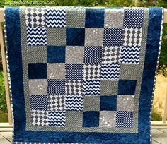 Baby Boy Quilt - Pink Polka Dot Creations - - A simple Baby Boy Quilt to piece together and to quilt. It is simply blocks sewn together with a couple of borders to finish it off! Quilt Baby, Baby Quilts Easy, Baby Boy Quilt Patterns, Baby Boy Knitting Patterns, Cot Quilt, Baby Girl Quilts, Flannel Quilts, Baby Boy Blankets, Baby Boys