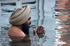 Amrit Sarovar | A Sikh man takes a holy bath in the Amrit Sa… | Flickr