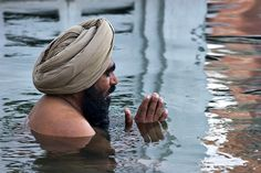Amrit Sarovar | A Sikh man takes a holy bath in the Amrit Sa… | Flickr