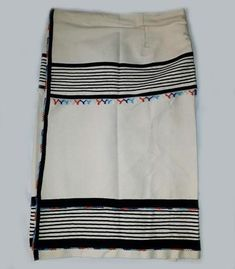 African mens wrap skirts made in genuine ibayi umbhaco style, with handcrafted bead and braiding detail. Shoelace Braid, Xhosa Attire, Man Skirt, African Men, African Design, Clothing Items, Traditional Outfits, Cheer Skirts, Cotton