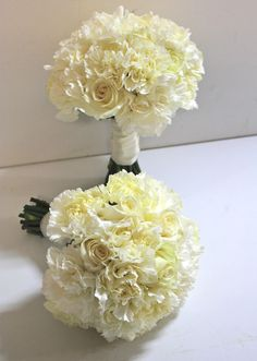 Very simple carnation bouquets with a few white roses....repinned by: Beneva Flowers - Sarasota, FL