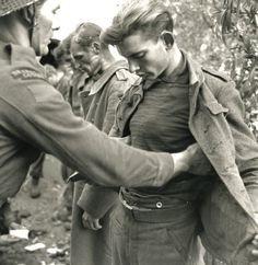 German prisoners of war being searched in Ortona, Italy. Canadian Soldiers, German Soldiers Ww2, Canadian Army, Canadian History, Vietnam War Photos, Prisoners Of War, Military Men, Military Ranks, History Photos