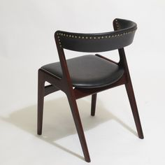 Kai Kristiansen Black Leather with Brass Dining Chairs | From a unique collection of antique and modern dining room chairs at https://www.1stdibs.com/furniture/seating/dining-room-chairs/