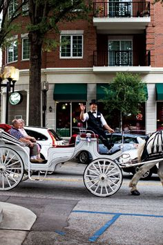 Greenville, SC in Garden & Gun. Photo Credit: Andrew Stephen Cebulka. A horse and carriage ride strolling down Main Street.