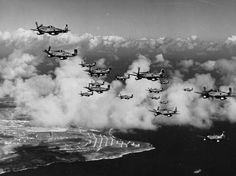On this day in history: Colonel James Beckwith commander of the 15th Fighter Group in his P-51 Mustang Squirt leading P-51s of the 45th Fighter Squadron from their base on Saipan to their new base on Iwo Jima 7 March 1945. Note the VLR tanks.