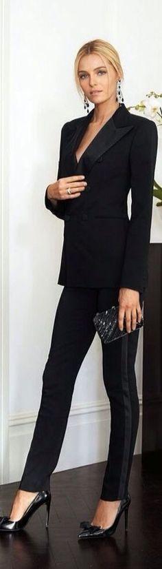 All black:  suit (cigar trousers); heels; clutch; earrings.