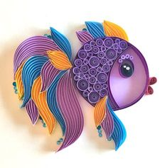 This quilled cutie fish artwork is handmade from 1 cm colorful strips of paper. The frame has no glass, it is a wood board. The dimensions of the board: 20x20x2.3 cm The dimensions of the artwork is 20x20cm