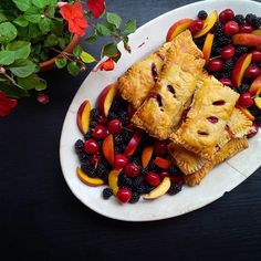 Summer party fare! With the help of my antique platter and the fruit vendors at the farmers market this dessert plate of homemade cherry hand pies, blackberries, peaches and cherries was super easy to make and transport in the car. So excited for all the possibilities of fruit season! #pie #peaches #desserts #baking #homemade #fromscratch #nashvillefarmersmarket #antiques #handpies #cherries🍒 #blackberries #freshfood #freshfruit #summer #partyfood #fruitplate #foodies #farmersmarket…
