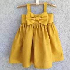 The original Big Bow dress in honey mustard is still the most loved. Its classic color will never go out of style! Handmade with precision and the very best quality craftsmanship this dress will not disappoint. Dresses are not guaranteed to arrive before Christmas as of today (12/05/12) Please email us about over night shipping or if the size you need is unavailable. Thank you!