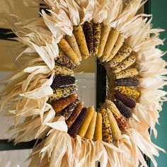 "Sunburst wreath Mimic a blazing sunburst with this fall wreath. Fold out the husks on ears of Indian corn so they point straight out from the tops. Hot-glue the ears to a straw wreath, and ""fluff"" the husks to complete the look. Indian Corn Wreath, Corn Husk Wreath, Straw Wreath, Diy Fall Wreath, Autumn Wreaths, Fall Diy, Wreath Ideas, Wreath Crafts, Decor Crafts"
