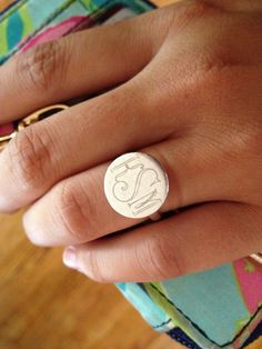 I love the monogram ring. This reminds me of my alma mater's ring...that I still regret not getting!
