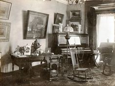 Here is typical parlor at the turn of the century. Floors were almost entirely carpeted and there were a number of chairs for various activities that would range from work to hosting company to just simply enjoying someone playing the piano.