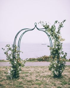 "The custom arch was covered by Forêt Design Studio with trailing clematis and crab apple branches for a simple, seasonal New England vibe. The ceremony was set on a grassy lawn outside of the fort's walls, and just before it began, the fog rolled in. ""It added such a beautiful element to the wedding,"" Jackie says. The setting of the historic American town, gave the Venezuelan guests a true introduction to a beloved spot of the couple's and the country from which Jackie hails."
