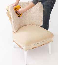 Cut a piece of batting to cover the chair back and another piece for the seat. Staple each piece in place, folding neatly around the corners.
