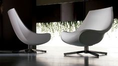 Contemporary leather swivel armchair OYSTER by Mauro Lipparini I 4 Mariani