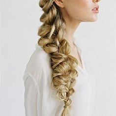 Big, pulled apart side braid wedding hair inspiration.