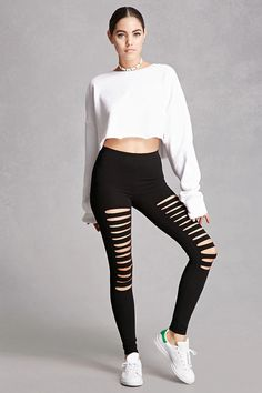 A pair of knit leggings featuring front raw-cut ladder cutouts and an elasticized waist. This is an independent brand and not a Forever 21 branded item.