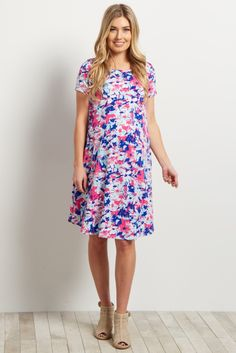Your favorite floral print now comes in bright hues for a bold statement piece this spring. A short sleeve cut and soft material keeps you comfortably cool all season long. Style this maternity dress with sandals for a beautiful ensemble for any occasion.