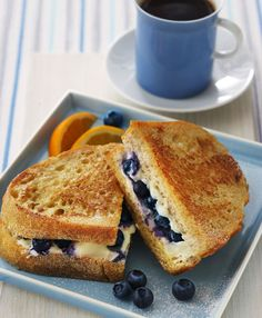 Breakfast grilled cheese: toast, cream cheese, and blueberries.