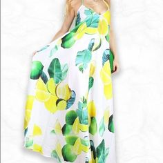 Rare all over citrus print maxi dress cross back Absolutely beautiful and rare maxi dress with an all over print, silky feel, and cross strap back. Brand-new with tags. Sold out but retails for over $100. Size Medium Kuccia Dresses Maxi