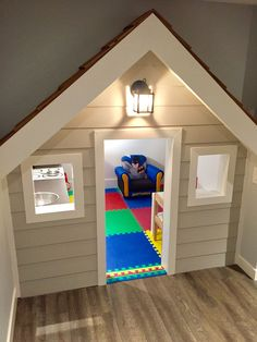 DIY playhouse built under stairs