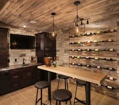 Tasting room with wine storage and a wet bar.