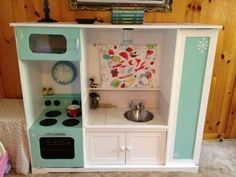 """TV stand turned into play kitchen!    ....since I made this one myself, this should technically be in the """"stuff i DID make for my babies"""" folder."""
