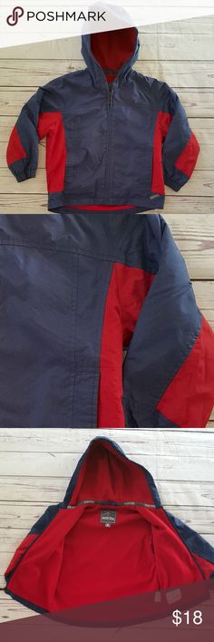 "Pacific Trail blue/red fleece lined hooded jacket Pacific Trail blue and red fleece lined hooded jacket. Full zip front and pockets. Pocket on left sleeve too. Excellent pre-owned condition from a smoke & pet-free home. See last picture for name written on inside label. Lining 100% nylon  Size M (5/6)  Measurements are approximate and taken laying flat: armpit to armpit: 18"" shoulder to hem: 18 3/4"" shoulder to cuff (drop shoulder): 15""   B5 Pacific Trail Jackets & Coats"
