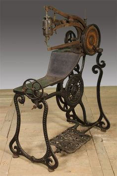 19TH CENT. CAST IRON SEWING MACHINE Elias Howe - the listing doesn't state this, but this machine was specifically made to sew shoes.