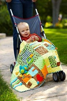 Add fun and function to a stroller-size quilt by sewing ribbon and rickrack loops into the blocks.